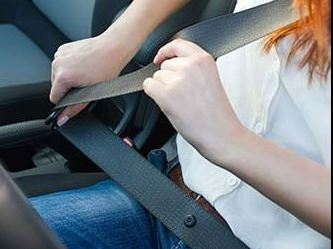 Woman buckling her seat belt