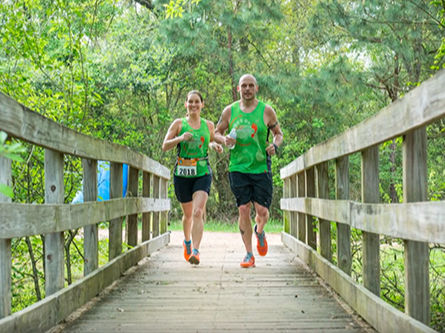 Seabrook Lucky Trails - People running on bridge